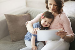 Little girl with her mom Stock Images