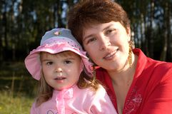 Little girl with her mother Stock Photography