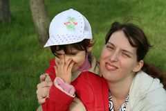 Little girl with her mother Royalty Free Stock Image