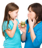 Little girl and her mother are anxious about time. Isolated over white Royalty Free Stock Images