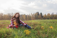 Little girl and her mother in  autumn park Stock Photography