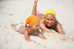 Little girl with her mother at the beach Royalty Free Stock Image