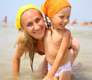 Little girl with her mother at the beach Royalty Free Stock Photography