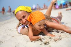 Little girl with her mother at the beach Stock Photo