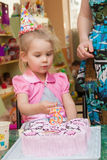 Little girl with her mother with a birthday cake Stock Photos