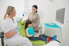 Little girl with her mother at dentist's office Stock Photo