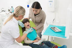 Little girl with her mother at dentist's office Stock Photos