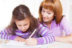 Little girl with and her mother drawing Royalty Free Stock Image