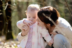 Little girl and her mother in a forest Stock Image