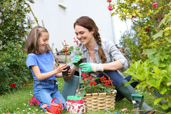 Little girl and her mother gardening Stock Photo