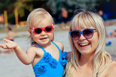 Little girl and her mother have a good time at the seaside resor Royalty Free Stock Images