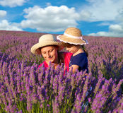 little girl with her mother are in a lavender field Royalty Free Stock Image