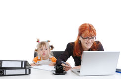 Little girl with her mother in the office. Royalty Free Stock Photo