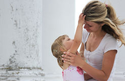 Little girl with her mother outdoors Royalty Free Stock Photography