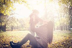 Little girl with her mother playing in park. stock photo