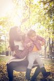 Little girl with her mother in park. stock image