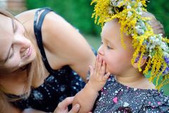 Little girl with her mother on a picnic Royalty Free Stock Image