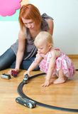 Little girl and her mother playing Stock Photo