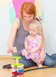 Little girl and her mother playing. Royalty Free Stock Photo