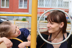 Little girl and her mother plays on playground Royalty Free Stock Photos