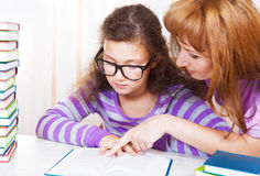Little girl with and her mother reading Stock Image