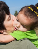 Little girl on her mother's shoulder Royalty Free Stock Photography