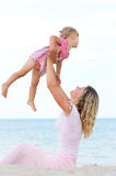 A little girl with her mother on the sea Stock Image