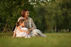 Little girl with her mother Stock Images
