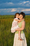Little girl and her mother staying outside Stock Photography