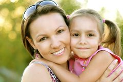 Little girl with her mother on a walk Royalty Free Stock Image