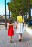 Little girl and her mother. Stock Photos