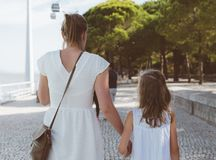 Family walking down the street. Royalty Free Stock Photography