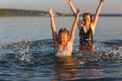 A little girl and her mother  in the water of the sea. Royalty Free Stock Photography