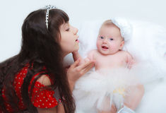 Little girl with her newborn baby sister Stock Photo