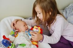 Little girl with her newborn brother Royalty Free Stock Photography