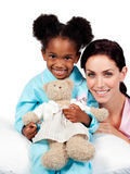 Little girl with her nurse looking at the camera Royalty Free Stock Photo