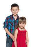 Little girl with her older brother Stock Photo