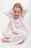 Little girl in her pajamas arranging her hair Stock Photography