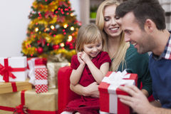 Little girl with her parents in Chrismtas time Stock Photos