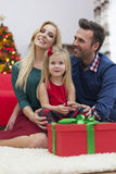 Little girl with her parents in Chrismtas time Stock Images