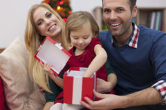 Little girl with her parents in Chrismtas time Royalty Free Stock Photo