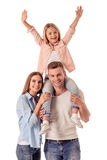 Little girl and her parents Stock Images