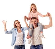 Little girl and her parents Stock Photography