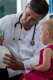 Little girl and her pediatrician Royalty Free Stock Photo