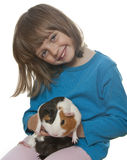 Little girl and her pet a guinea pig Royalty Free Stock Photo