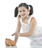 Little girl with her piggy bank Royalty Free Stock Photography
