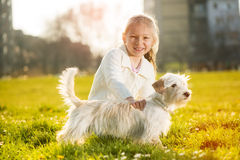 Little girl with her puppy dog Stock Photos