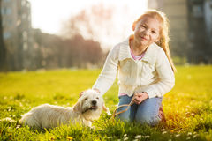 Little girl with her puppy dog Stock Image