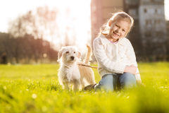 Little girl with her puppy dog Stock Photography