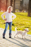 Little girl with her puppy dog Royalty Free Stock Images